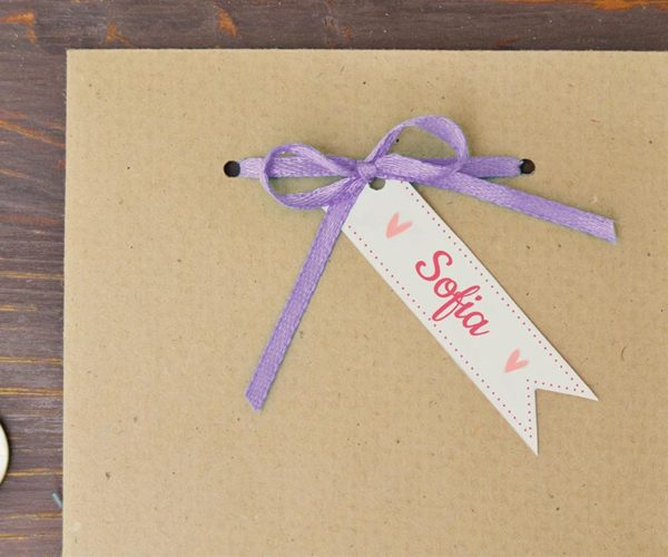 Kraft packaging with tag and ribbon