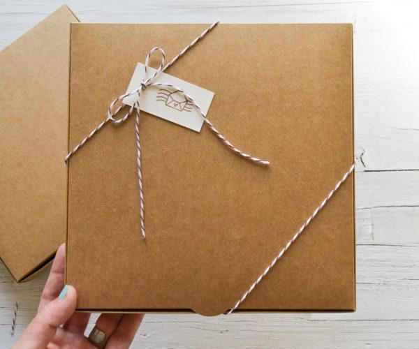 Kraft box with tag and ribbon